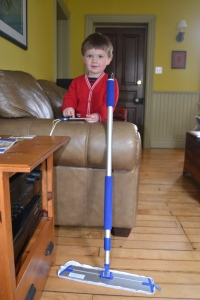 Preschooler cleans floor